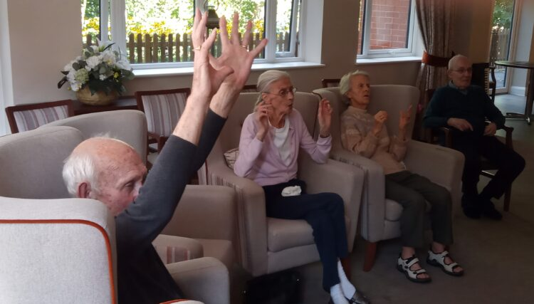 Twyford House residents trying some of the yoga poses on Zoom